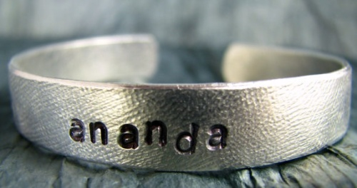 http://www.etsy.com/listing/100929310/ananda-yoga-jewelry-ananda-bangle